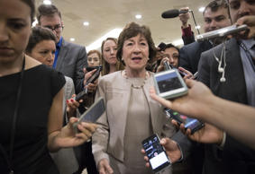 Sen. Susan Collins, R-Maine is surrounded by reporters as she arrives on Capitol Hill in Washington, Tuesday, July 25, 2017, before a test vote on the Republican health care bill.