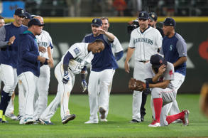 Seattle Mariners celebrate after Jean Segura #2, center, of the Seattle Mariners...
