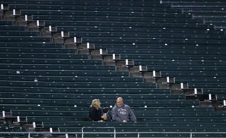 Three fans sit in the left field bleachers before the Chicago White Sox take on the Tampa Bay Rays at U.S. Cellular Field on September 28, 2016 in Chicago, Illinois. (Photo by Jonathan Daniel/Getty Images)
