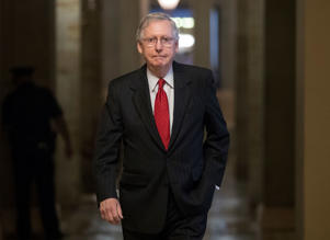 Senate Majority Leader Mitch McConnell of Ky. walks from his office to the Senate floor on Capitol Hill in Washington, Wednesday, July 26.