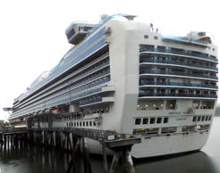 The Emerald Princess cruise ship is docked in Juneau, Alaska, Wednesday, July 26, 2017. The FBI is investigating the domestic dispute death of a Utah woman on board the ship, which was traveling in U.S. waters outside Alaska.