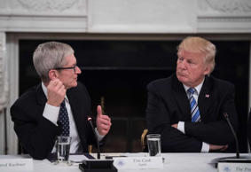 US President Donald Trump listens to Apple CEO Tim Cook speak during an American Technology Council roundtable at the White House in Washington, DC, on June 19, 2017.