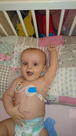 The tot remained upbeat during his recovery (Image: Jenny Murphy)