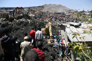 ADDIS ABABA, ETHIOPIA - MARCH 12 : Rescue workers search for those buried by a landslide that swept through a massive garbage dump, killing at least 10 people and leaving several missing at Koshe rubbish tip in Kolfe Keranio district of Addis Ababa, Ethi