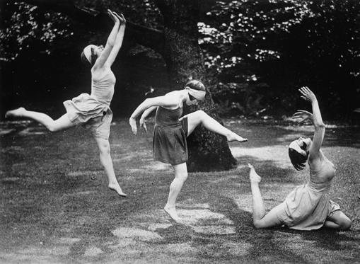 Slide 1 of 32: Dancers from the Margaret Morrison ballet are rehearsing in a park in London, enjoying the beautiful spring weather. Photograph. Around 1935.