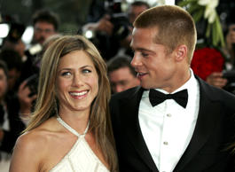 Actor Brad Pitt (R) escorts his wife actress Jennifer Aniston during red carpet ...