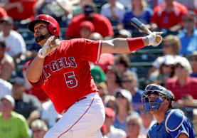 Los Angeles Angels' Albert Pujols follows through on a solo home run against the Los Angeles Dodgers during the first inning of a spring training baseball game, Monday, March 13, 2017, in Tempe, Ariz.