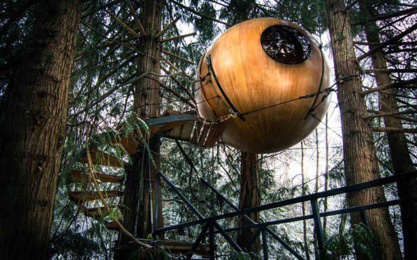 Eryn, British Colombia - Tom Chudleigh spent four years building this spherical tree-top nest in the canopy of a Vancouver forest. He rents out the pod, which boasts a bed, kitchenette and table, and also uses it as a writing retreat when the distractions of everyday life get too much.