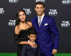 Real Madrid and Portugal's forward Cristiano Ronaldo poses with partner Georgina Rodriguez and his son Cristiano Ronaldo Jr as they arrive for The Best FIFA Football Awards 2016 ceremony, on January 9, 2017 in Zurich. / AFP / MICHAEL BUHOLZER (Photo credit should read MICHAEL BUHOLZER/AFP/Getty Images)