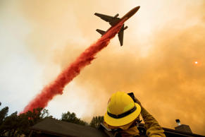 An air tanker drops retardant while battling a wildfire near Mariposa, Calif., Wednesday, July 19, 2017. The fire has forced thousands of people from homes in and around a half-dozen small communities, officials said.