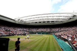 A general view of centre court as Roger Federer of Switzerland plays a forehand during the Gentlemen's Singles final against Marin Cilic of Croatia on day thirteen of the Wimbledon Lawn Tennis Championships at the All England Lawn Tennis and Croquet Club at Wimbledon on July 16, 2017 in London, England.