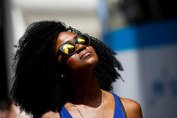 A woman looks up at the sun during a hot day in New York City on July 20, 2017.