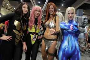 From left, women play the parts of Wasp from Marvel Comics, Pixie from X-Men, Red Sonja from Marvel Comics and Samus from Nintendo during Comic-Con 2017 in San Diego, California, July 20, 2017. / AFP PHOTO / Bill Wechter (Photo credit should read BILL WECHTER/AFP/Getty Images)