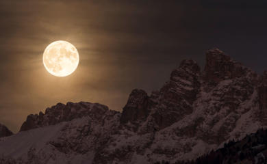 The magnificent sight of the Super Moon illuminating the night sky as it sets behind the Marmarole, in the heart of the Dolomites in Italy. By Giorgia Hofer (Italy).