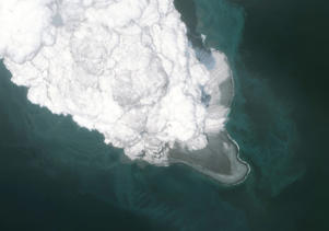 This is an AFTER ERUPTION DigitalGlobe satellite overview image of the Bogoslof Volcano, in the Aleutian island chain in Alaska.