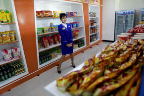 A vendor is pictured in a shop in a newly constructed residential complex after its opening ceremony in Ryomyong street in Pyongyang, North Korea April 13, 2017.