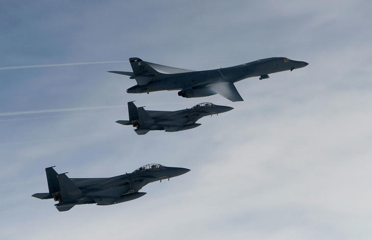KOREAN PENINSULA, SOUTH KOREA - JULY 08: In this handout photo released by the South Korean Defense Ministry, A U.S. Air Force B-1B Lancer bomber (top) fly with South Korean jets over the Korean Peninsula during a South Korea-U.S. joint live fire drill on July 8, 2017 in Korean Peninsula, South Korea.