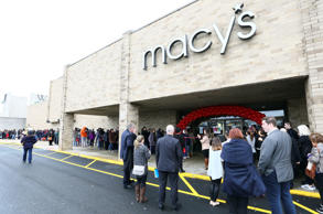 Macy's customers wait in line for the grand opening of Macy's Backstage inside Macy's at Woodbridge Center Mall in Woodbridge, N.J., Saturday, April 1, 2017.