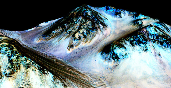 Slide 1 of 77: HALE CRATER, MARS - UNSPECIFIED DATE: In this handout provided by NASA's Mars Reconnaissance Orbiter, dark, narrow streaks on the slopes of Hale Crater are inferred to be formed by seasonal flow of water on surface of present-day Mars. These dark features on the slopes are called 'recurring slope lineae' or RSL. Scientists reported on September 28, 2015 using observations with the Compact Reconnaissance Imaging Spectrometer on the same orbiter detected hydrated salts on these slopes at Hale Crater, corroborating the hypothesis that the streaks are formed by briny liquid water. (Photo by NASA/JPL-Caltech/Univ. of Arizona via Getty Images)