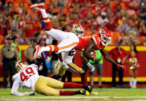 Chris Conley (17) of the Chiefs is upended by Lorenzo Jerome (49) of the 49ers after making a catch on Friday in Kansas City, Missouri. The 49ers won 27-17.