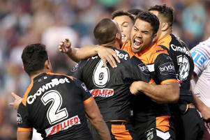 Esan Marsters and Tuimoala Lolohea of the Tigers celebrate after Tuimoala Lolohea scored a try during the round 23 NRL match between the Wests Tigers and the Manly Sea Eagles at Leichhardt Oval on August 13, 2017 in Sydney, Australia.