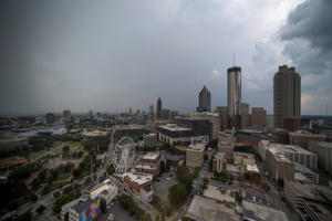The city skyline is seen has thunderstorms move through in this July 24, 2017, file photo in Atlanta.