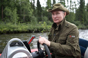 Putin controls a boat during the hunting and fishing trip  in the republic of Tyva in southern Siberia, Russia.