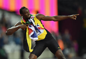 Usain Bolt of Jamaica celebrates during a lap of honour following finishing in third place in the mens 100m final during day two of the 16th IAAF World Athletics Championships London 2017.