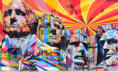 A woman looks back while pushing her stroller past a giant mural of Mt. Rushmore by Brazilian streetartist Eduardo Kobra on La Brea Avenue in Los Angeles on August 20, 2013 in California. AFP PHOTO/Frederic J. BROWN (Photo credit should read FREDERIC J. BROWN/AFP/Getty Images)