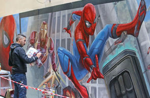 CAPTION: MELBOURNE, AUSTRALIA - JUNE 08: Apparition Media artist David Pereirra paints the final parts of the Spider-Man: Homecoming mural on June 8, 2017 in Melbourne, Australia. Apparition Media were commissioned by Sony Pictures to paint a mural to celebrate their new film Spider-Man: Homecoming, which will release in Australian cinemas on July 6, 2017. (Photo by Scott Barbour/Getty Images)