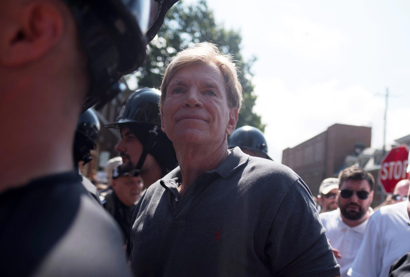 David Duke (C), participates in a rally where a crowd of white nationalists are met by a group of counter-protesters in Charlottesville, Virginia, U.S., August 12, 2017