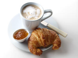 French croissant coffee and orange marmalade