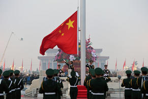 Soldiers of Chinese National Flag Guard of Honor raise the national flag at Tiananmen Square on the National Day on October 1, 2016 in Beijing, China. Thousands of tourists gathered at Tiananmen Square to watch the flag-raising ceremony on the National Day in Beijing.