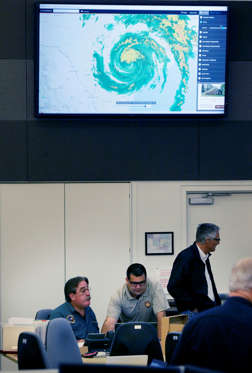 Slide 3 of 65: Emergency management officials monitor the situation with tropical storm Harry at the operations center in San Antonio Saturday, Aug. 26, 2017. As hurricane Harvey fades to a tropical storm, local officials are keeping track of rain fall amounts and the need of emergency assets in South Texas.