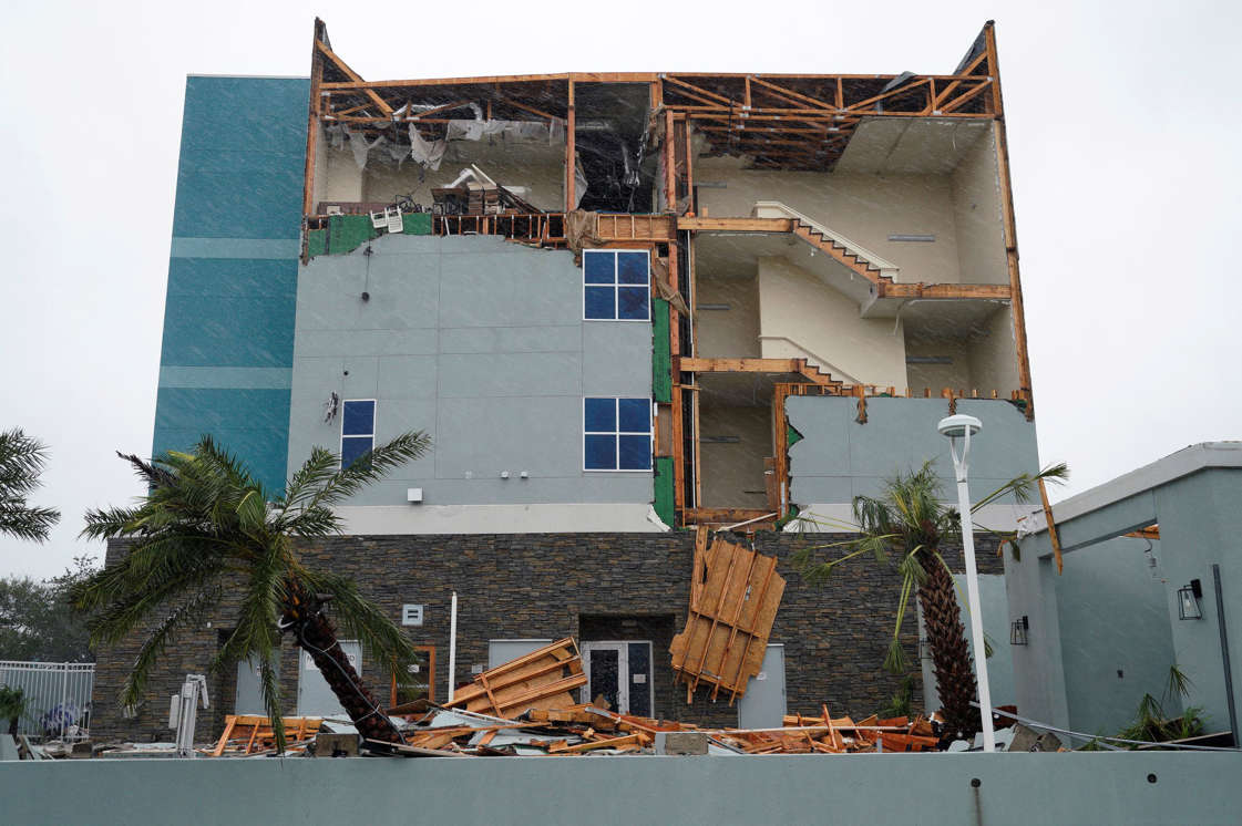 Slide 11 of 77: The end wall of the Fairfield Inn is seen partially missing after Hurricane Harvey struck in Rockport, Texas, August 26, 2017.