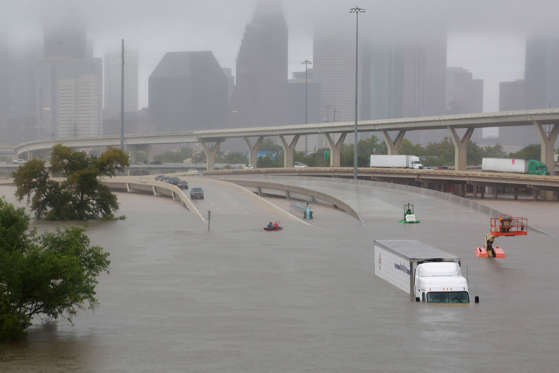 Slide 1 of 92: Interstate highway 45 is submerged from the effects of Hurricane Harvey seen during widespread flooding in Houston, Texas, U.S. August 27, 2017. REUTERS/Richard Carson TPX IMAGES OF THE DAY - RTX3DL7M
