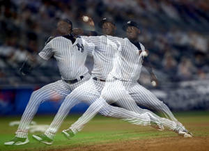 NEW YORK, NY - AUGUST 15:  (EDITORS NOTE: Multiple exposures were combined in camera to produce this image.) Aroldis Chapman #54 of the New York Yankees delivers a pitch in the ninth inning against the New York Mets during interleague play on August 15, 2017 at Yankee Stadium in the Bronx borough of New York City.  (Photo by Elsa/Getty Images)