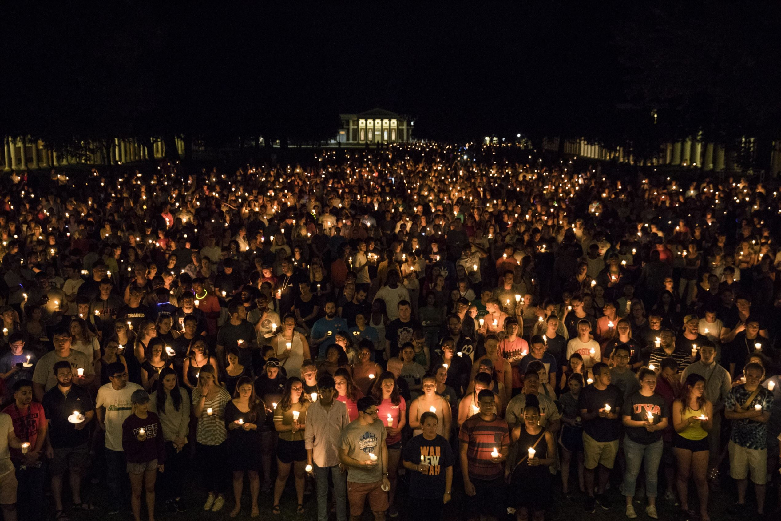 Hundreds carry lit candles across UVA campus against white nationalism