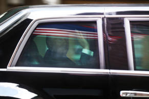 U.S. President Donald Trump waves from his motorcade vehicle after departing Trump Tower on August 16, 2017 in New York City.