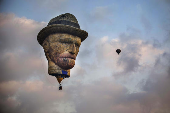 Slide 1 of 31: CAPTION: NORTHEN NEGEV, ISRAEL - AUGUST 11: A hot air balloon in the form of Dutch painter Vincent Van Gogh flies during the 6th edition of annual International Hot Air Balloon Festival at Eshkol National Park located in Northen Negev in Israel on August 11, 2017. (Photo by Stringer/Anadolu Agency/Getty Images)