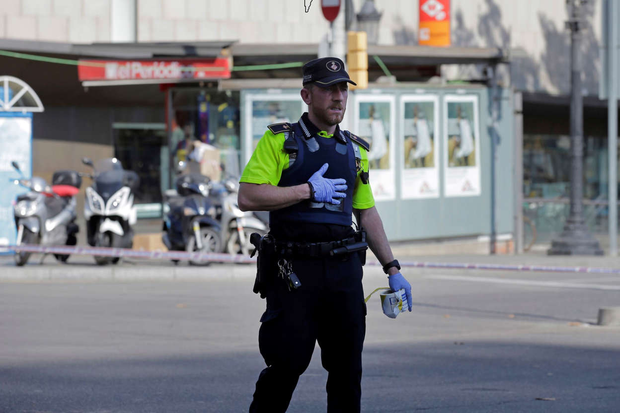 A police officer cordons off a street in Barcelona, Spain, Thursday, Aug. 17, 2017.