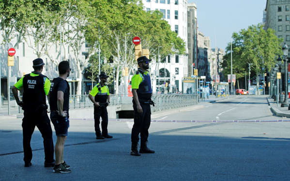 Slide 19 of 19: Police officers cordon off a street in Barcelona, Spain, Thursday, Aug. 17, 2017. Police in the northern Spanish city of Barcelona say a white van has jumped the sidewalk in the city's historic Las Ramblas district, injuring several people. (AP Photo/Manu Fernandez)