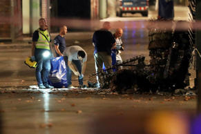 Forensic police officers search for clues near the area where a van crashed into pedestrians at Las Ramblas in Barcelona, Spain on Aug. 17.