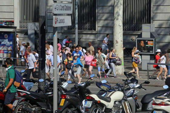 Slide 4 of 19: People flee the scene in Barcelona, Spain, Thursday, Aug. 17, 2017 after a white van jumped the sidewalk in the historic Las Ramblas district, crashing into a summer crowd of residents and tourists and injuring several people, police said. (AP Photo/Oriol Duran)