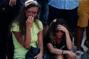 People mourn at La Rambla Boulevard for the victims those who lost their lives i...