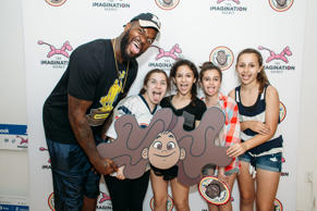 Martellus Bennett poses with attendees during the Hey AJ Imagination Lounge Pop Up on June 17, 2016 in Boston, Massachusetts.
