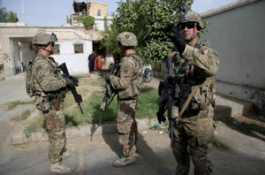 U.S. military forces stand guard during a visit by Kabul's officials in the governor's compound in Kandahar, Afghanistan, Thursday, Aug. 4, 2016.
