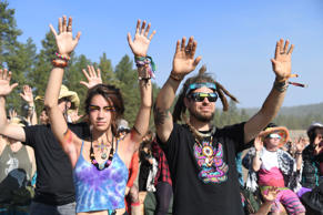 "People watch the start of the solar eclipse and raise their hands in prayer in an eclipse viewing event led by Native American elders, at Big Summit Prairie ranch in Oregon's Ochoco National Forest near the city of Mitchell on August 21, 2017. The Sun started to vanish behind the Moon as the partial phase of the so-called Great American Eclipse began Monday, with millions of eager sky-gazers soon to witness ""totality"" across the nation for the first time in nearly a century. / AFP PHOTO / Robyn Beck        (Photo credit should read ROBYN BECK/AFP/Getty Images)"