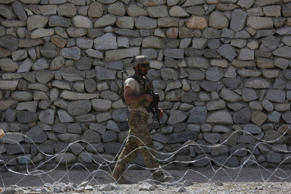 U.S. soldier is seen in Asad Khil village near the site of a U.S. bombing in the Achin district of Jalalabad, east of Kabul, Afghanistan, Saturday, April 17, 2017.