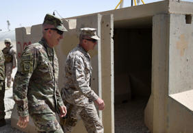 The U.S. commander in Afghanistan. John Nicholson, left, walks with Marine Brig. Gen. Roger Turner in Lashkar Gah in the Afghan province of Helmand on April 29.